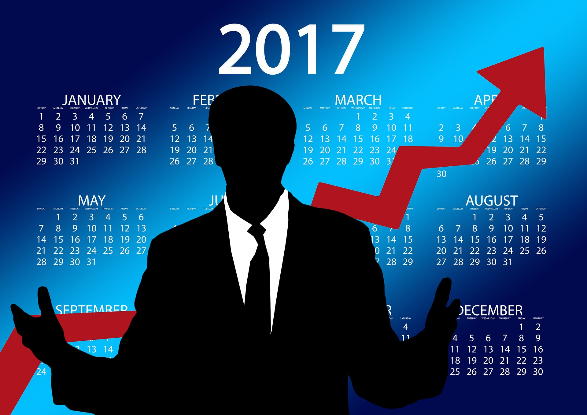 2017年のカレンダーと解説する男性。