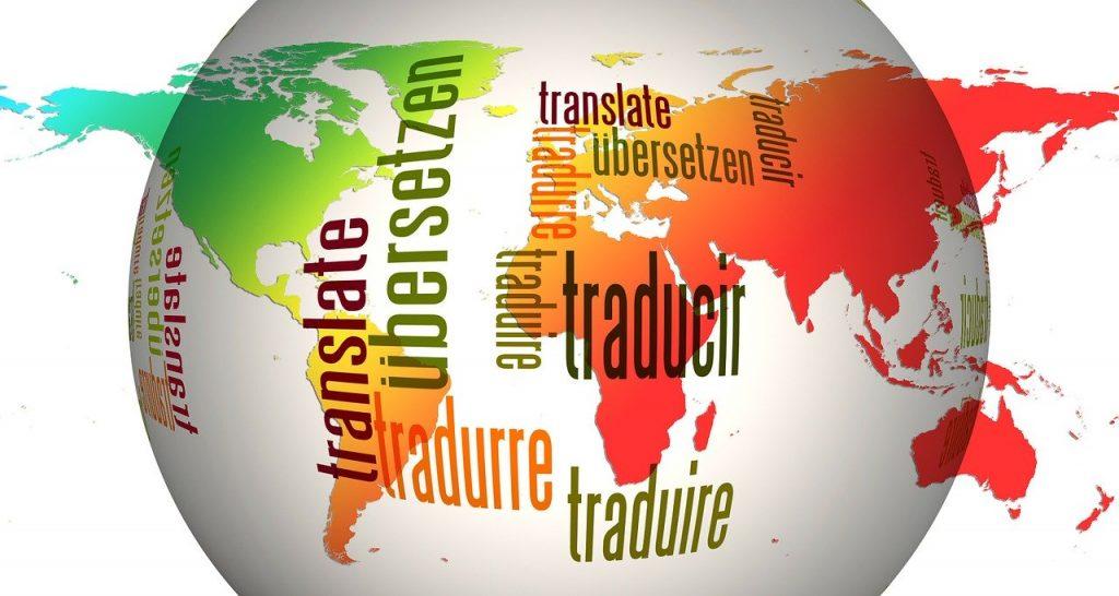 世界地図と翻訳・transrate・traducirの文字・世界翻訳の日のイメージ
