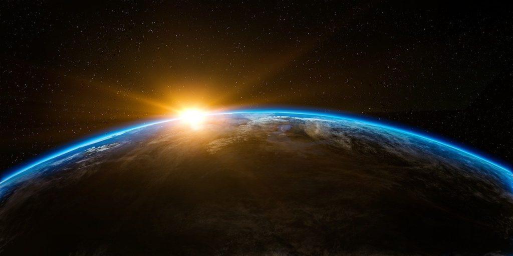 宇宙・地球・日の出のイメージ画像